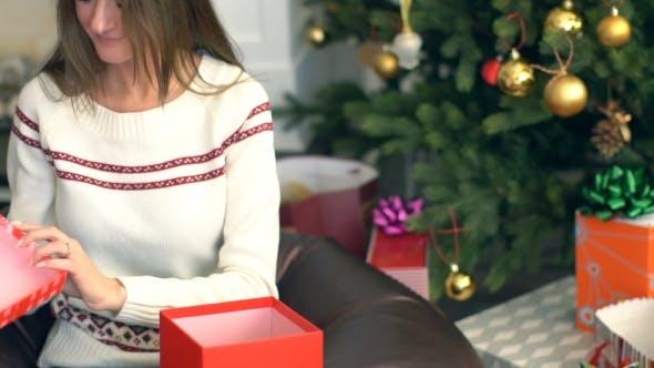 Thumbnail for Pretty Smiling Girl Open Christmas Gift