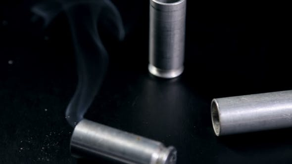 Cover Image for Weapons Shells Falling On The Table With The Smoke