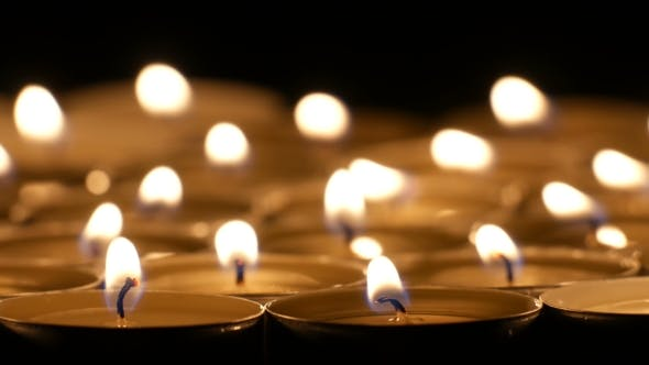 Cover Image for Tea Candles Burning At Night