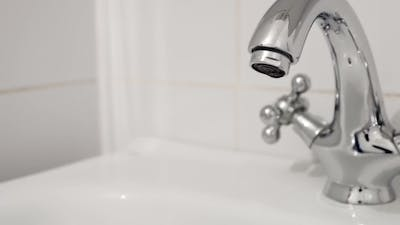 Faucet Turned On Filling The Sink With Water