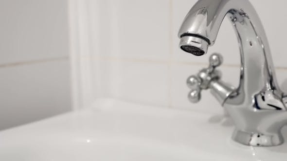 Thumbnail for Faucet Turned On Filling The Sink With Water