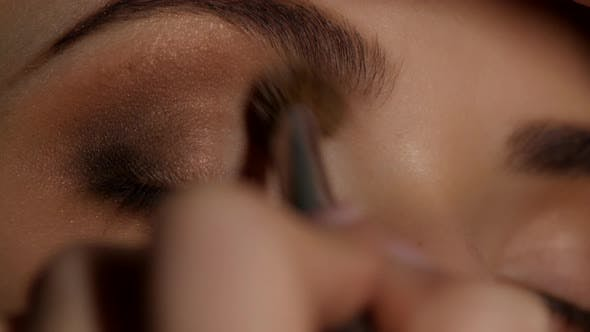 Thumbnail for Makeup Artist Working on a Young Girl Beauty. Eyeshadow. Closeup