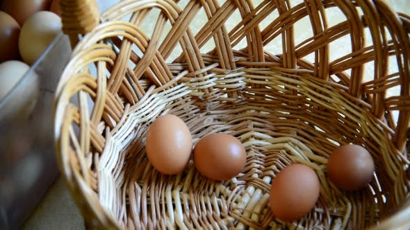 Thumbnail for Woman Adds Eggs In Wicker Basket