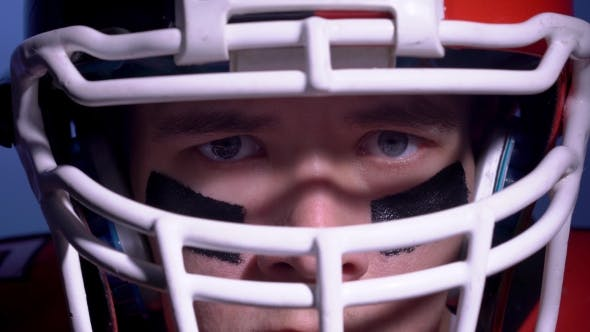 Thumbnail for An American Football Player Touching His Helmet