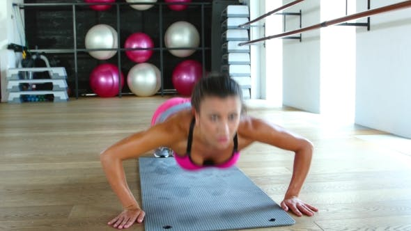 Thumbnail for Woman Fitness Workout Wellness Concept. Athlete Girl Does Exercises On The Gym
