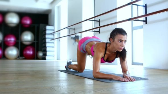 Thumbnail for Healthy Young Woman Working Out In Gym
