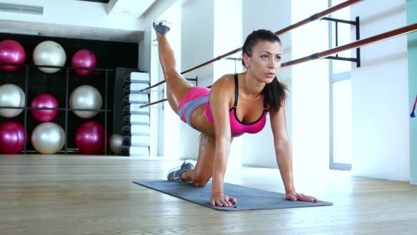Thumbnail for Young Beautiful Fitness Girl Exercising In The Gym