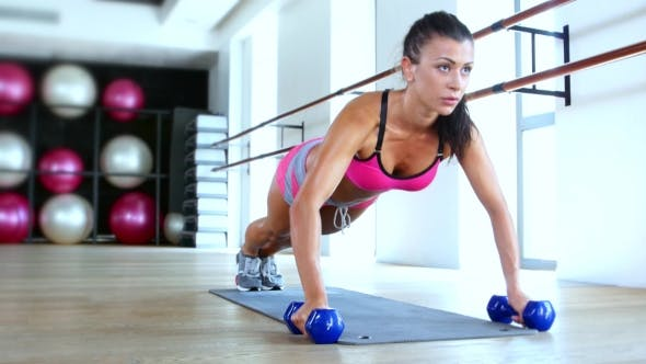 Thumbnail for Brunette Woman At Gym Push Up Push-up Workout Exercise With Dumbbells
