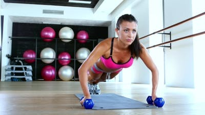 Woman At Gym Push Up Push-up Workout Exercise With Dumbbells.