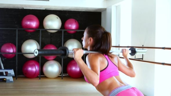 Thumbnail for Sporty Woman Doing Squat Workout In Gym