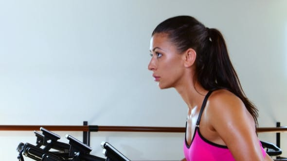 Thumbnail for Sporty Woman At The Gym On Bike. Sunny Gym