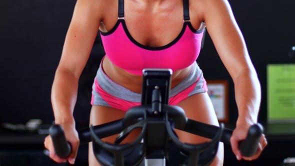 Thumbnail for Girl Doing Exercises On Stationary Bike In The Gym