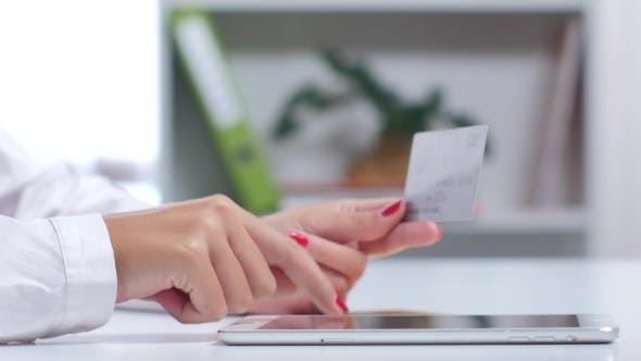 Thumbnail for Woman Buying Online With a Silver Credit Card And Tablet.