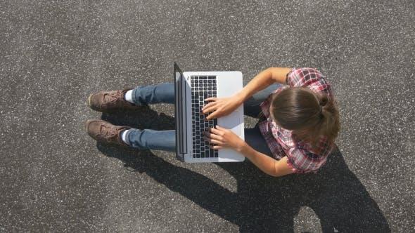 Thumbnail for Laptop On Asphalt