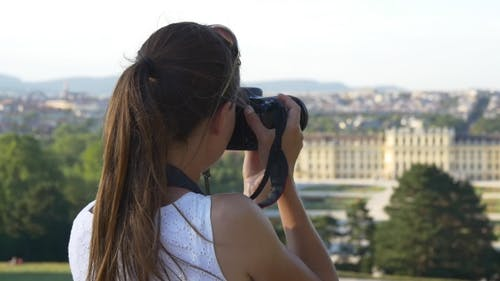Woman Photographing Austrian Cityscape