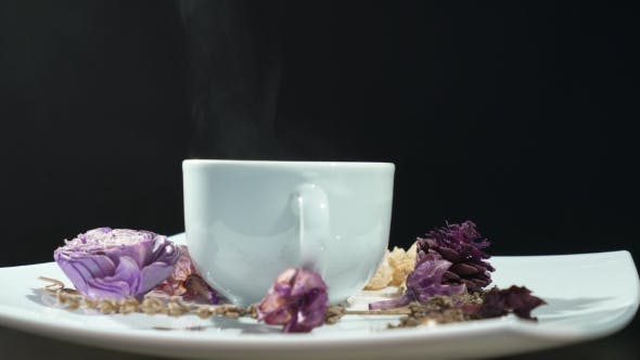 Thumbnail for Cup Of Tea With Flowers Rotation Isolated On Black