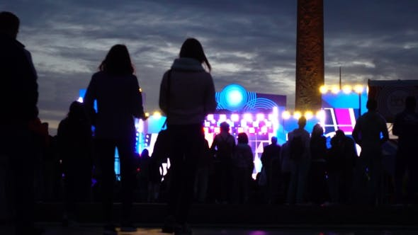 People Silhouettes Heading For Night Live Show.  Shot