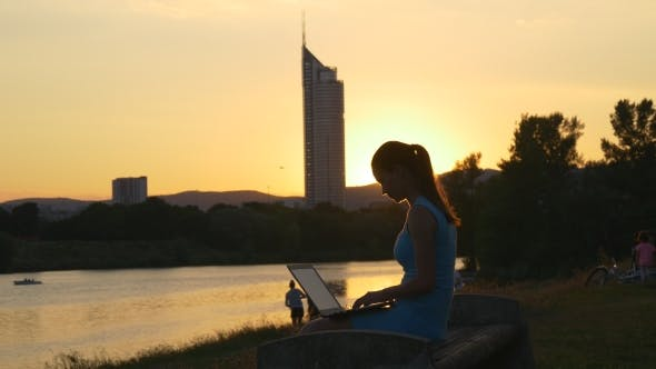 Thumbnail for Silhouette Of a Woman With a Laptop