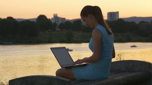 Woman In An Evening Dress With Laptop