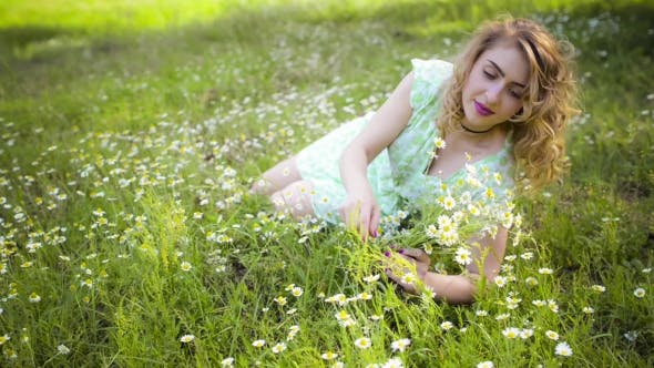 Thumbnail for Girl Resting On The Nature. Beautiful Girl Lying On The Field.