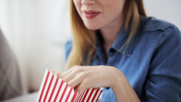 Thumbnail for Happy Woman Eating Popcorn And Watching Tv At Home
