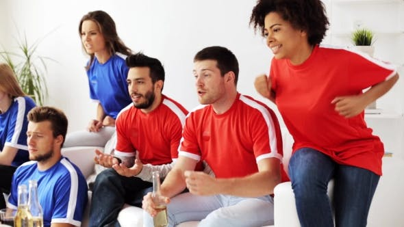 Cover Image for Friends Or Football Fans Watching Soccer At Home