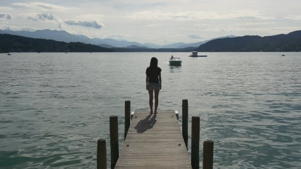 Thumbnail for Woman Waiting For Approaching Powerboat