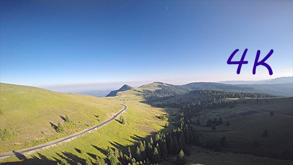 Thumbnail for Aerial View of Car Driving on the Forested Road and Beautiful Mountains at Horizon
