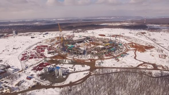 Thumbnail for Aerial Panorama Of Stadium Construction Near Bare Forest In Winter