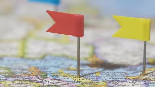 Experienced Traveler Pointing Pins Visited Places on World Map, Active Lifestyle