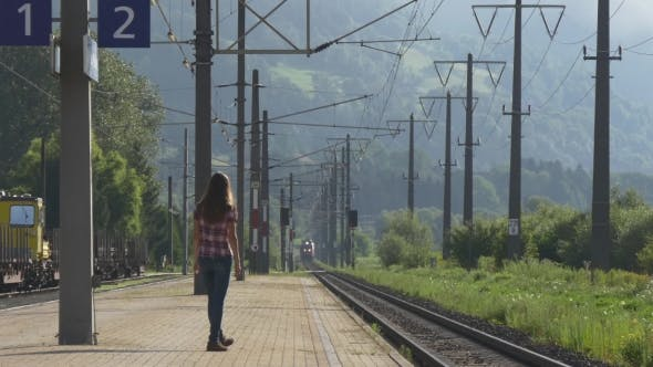Train Arriving to The Station. Woman is Waiting