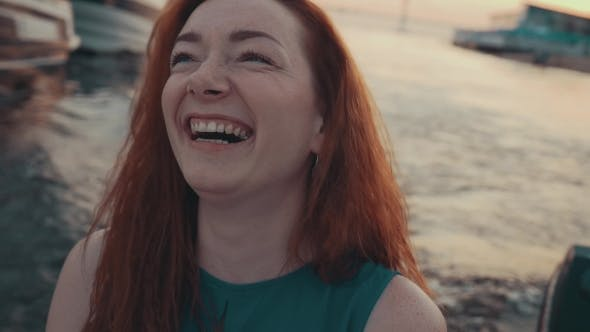 Thumbnail for Attractive Red Hair Girl In Turquoise Dress On Motor Boat. Summer Evening. Laugh