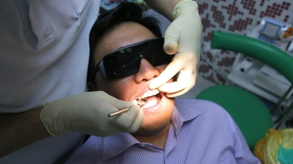 Thumbnail for Dentist Is Healing Client Teeth With Mouth Mirror.