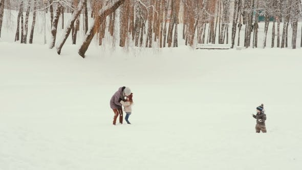 Thumbnail for Young Mother With Her Children Playing And Having Fun In The Snow