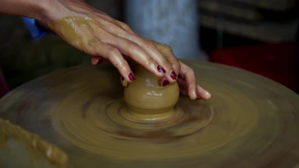 Thumbnail for Lady Hands Make Clay Pot Neck on Rotating Potter Wheel