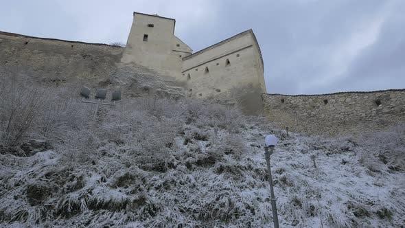 Low angle of Rasnov Citadel on a winter day