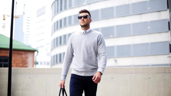 Thumbnail for Young Man With Sunglasses And Bag Walking In City