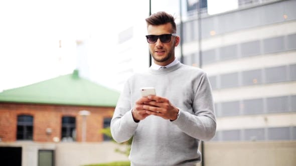 Thumbnail for Man In Sunglasses With Smartphone On City Street
