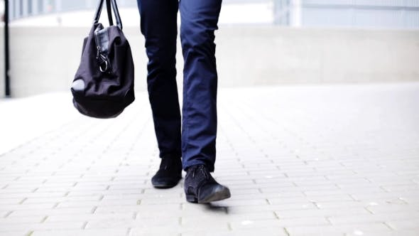 Thumbnail for Young Man With Bag Walking Along City Street