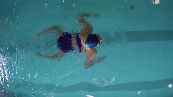 Thumbnail for Female Swimmer Practicing Breaststroke