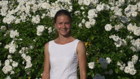 Thumbnail for Woman Near Plenty Of Blooming White Roses