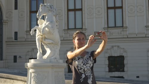 Selfie On The Background Of The Horse Statue