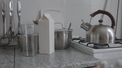 Boiling Kettle And Crockery In The Kitchen