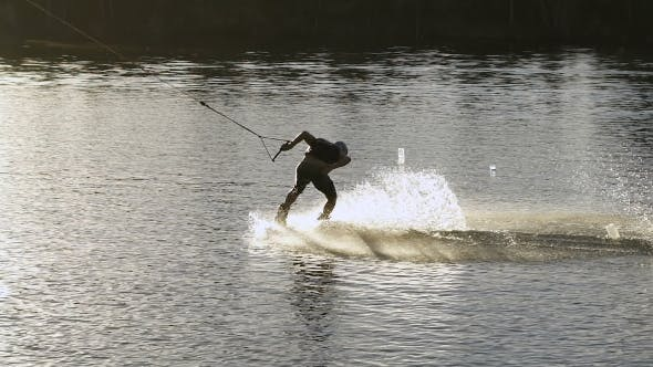 Thumbnail for Wakeboarder Making Tricks On Sunset