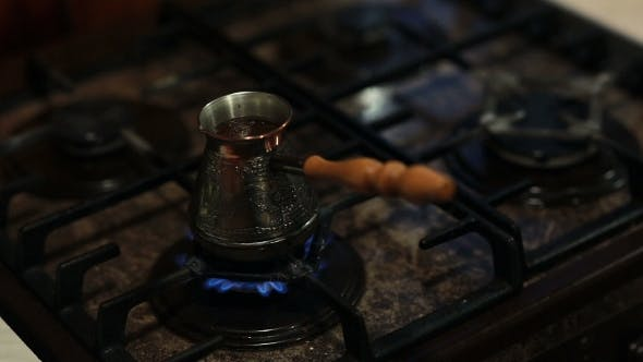 Thumbnail for A View Of Coffee In a Coffee Pot Preparing On Fire.