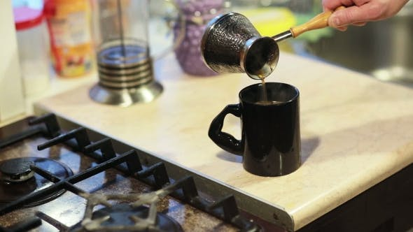 Thumbnail for Man Taking The Pot And Pouring Coffee In a Mug.