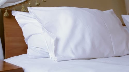 Woman Runs The Linen On The Bed