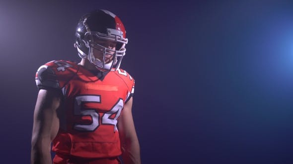 Thumbnail for American Football Player In Red Outfit Warming Up