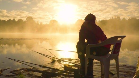 Thumbnail for Fisherman At Sunrise Fishing On The Float Rod.