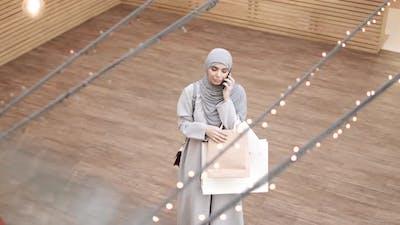 Beautiful Woman in Hijab Talking on Cellphone